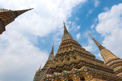 Three Pagodas in Wat Po with blue sky Stock Photos