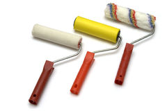 Three paint rollers Stock Images