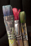 Three paintbrushes in different colors Stock Photo