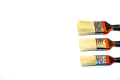 Three paint brushes. Isolated on a white background Stock Photo