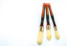 Three paint brushes. Three paintbrushes isolated on a white background Royalty Free Stock Photo
