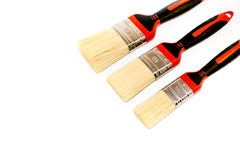 Three paint brushes. Six paint brushes isolated on a white background Stock Photos
