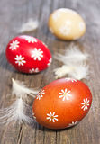 Three painted easter eggs. On wooden table Stock Image