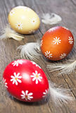 Three painted easter eggs. On wooden table Stock Photo