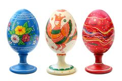 Three Painted Easter Eggs. Three different painted Easter eggs with patterns standing on supports isolated on a white background Royalty Free Stock Photography