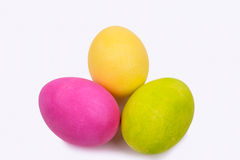 Three painted Easter eggs on a white background. Three painted Easter eggs, one yellow, one green and one pink on a white background Royalty Free Stock Image