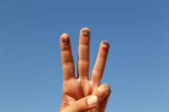 Three painted fingers with sky background. Three painted fingers with sky at background stock photo