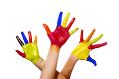 Three painted hands with clipping path. Three hands painted in different colours raised up stock photo