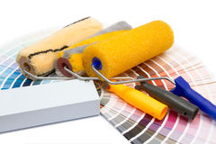 Three painting rollers and album of colors Stock Photography