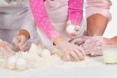 Family  kneading  dough Royalty Free Stock Photography