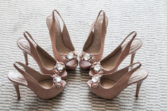 Three pairs. Dark pink, orange shoes for the bride's maids Royalty Free Stock Image