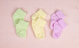 Three pairs of baby socks Stock Photography