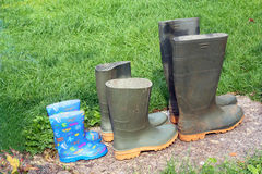 Three pairs of boots. Family. Stock Images
