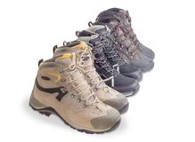 Three pairs boots for trekking on a white background Stock Photo