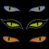 Three pairs of cat eyes over black. Three pairs of beautiful cat eyes on a black background, hand drawing vector illustration Stock Photo