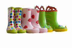 Three pairs of children's coloured rubber boots, cut out Royalty Free Stock Images