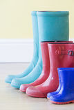 Three Pairs Of Colorful Gumboots In A  Row Stock Photo