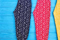 Three pairs of colorful pants close up. Royalty Free Stock Photo