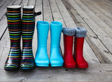 Three pairs of a colorful rain boots. Family concept Royalty Free Stock Image