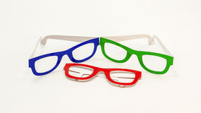 Three pairs of coloured eyeglasses Royalty Free Stock Photos