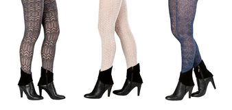 Three pairs of female legs in pantyhose Royalty Free Stock Images