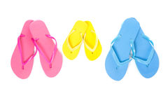 Three pairs of flip flops on white Royalty Free Stock Photography