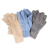 Three pairs of knitted gloves Stock Photos