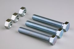 Three pairs nuts and bolts Royalty Free Stock Photo