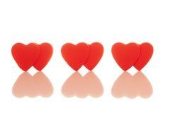 Three pairs of red hearts Royalty Free Stock Photos