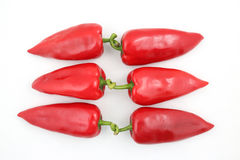 Three pairs of red sweet pepper on white background Stock Images