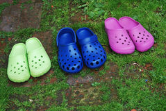 Three pairs of rubber slippers Stock Photography