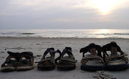 Three Pairs of Shoes. Near the sea stock photography