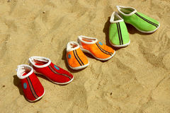 Three pairs of shoes for the beach Stock Photos