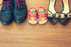 Three pairs of shoes: men, women and children. Stock Images