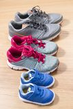 Three pairs of sneakers. For the whole family, dad, mom and child Stock Image
