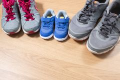 Three pairs of sneakers. For the whole family, dad, mom and child Stock Photos