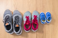 Three pairs of sneakers. For the whole family, dad, mom and child Royalty Free Stock Photo