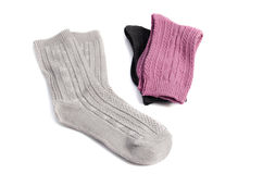Three pairs of socks of different colors. Isolated on white Stock Images
