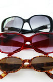 Three pairs of sunglasses Stock Photography