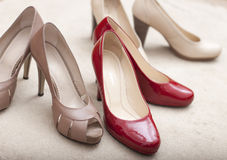 Three pairs of  woman's shoes Stock Photos