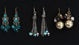 Three pairs of women's earrings Royalty Free Stock Images