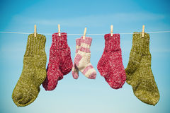 Three pairs of woolen socks Stock Photos