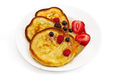 Three pancakes with berries Stock Photo