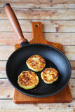 Three pancakes in a frying pan Royalty Free Stock Photo