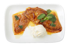 Three pancakes with orange sauce Stock Photos