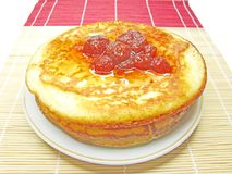Three pancakes with strawberry jam Stock Images