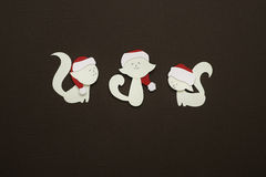 Three paper cats applique on texture background Stock Photo