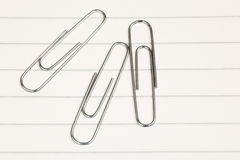 Three paper clips Stock Photos