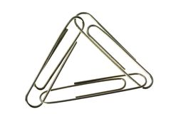 Three paper clips interlinked royalty free stock photography