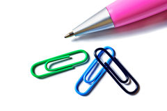 Three paper clips and the pen. Stock Images